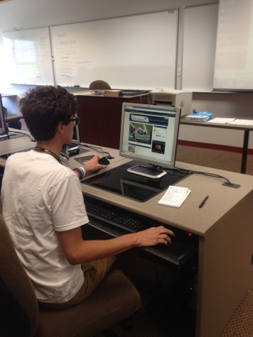 Parkway West student  Jacob Cupps works on revamping his online site.