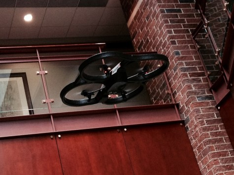 "Flying above, is the $300 drone that Chris Snider, associate professor at Drake University, bought  for students. ""What I just try to do is to introduce it to students and use it in whatever manner we can, use it and then talk about how this could change things,"" Snider said."