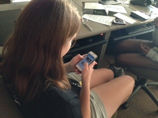 A student journalist takes a break from all the hard work. Lila Alvarado browses Twitter on her phone.