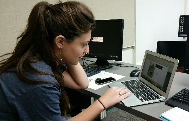 Jessica Schell working on a design for a football page.