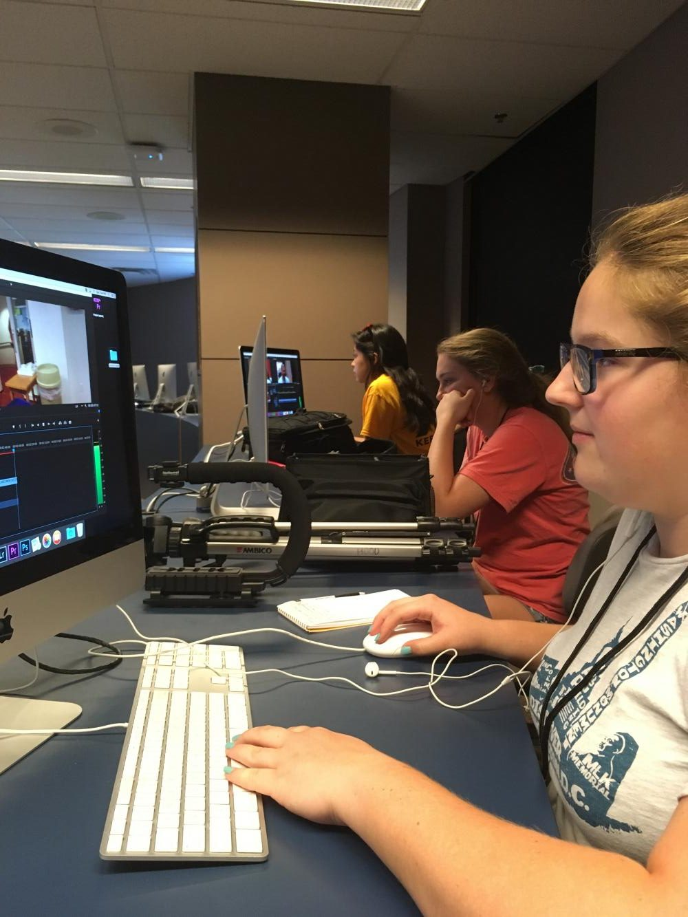 Reide Pearson (front) edits her B-roll footage in the Video Storytelling and Editing class on June 24. Students will continue to work on footage and make their own package by the end of camp.