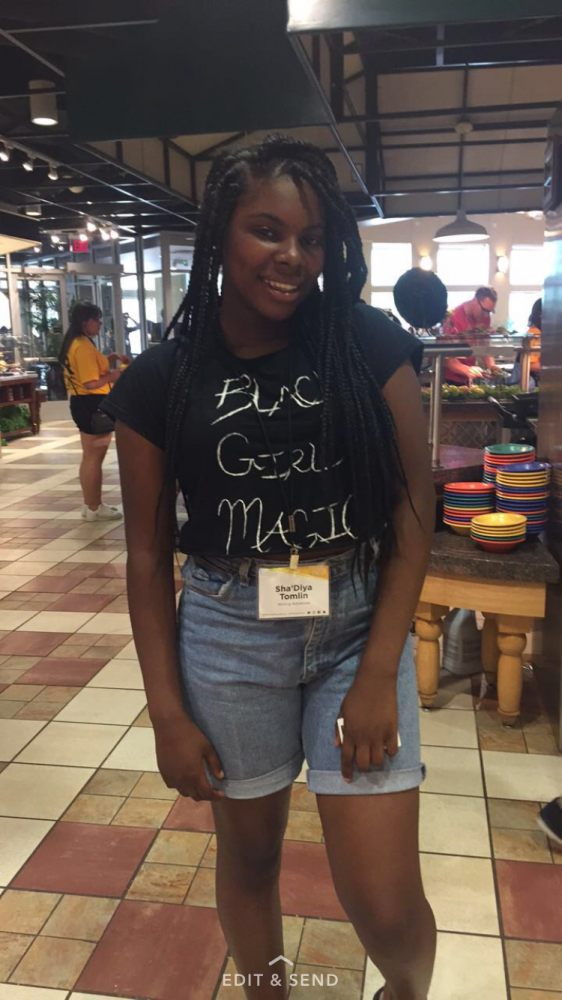 Sha'Diyah Tomlin, upcoming senior at Kirkwood High School, walks through the dining hall. She enjoys writing poetry and news stories, so this camp gave her a good outlet. Annie Schorgl/Photo